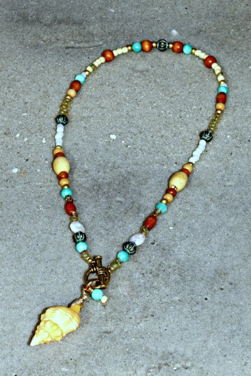 tangerine colored horse conch pendant, wood, freshwater pearl, seed bead,turquoise and copper metal beads, toggle clasp 18""