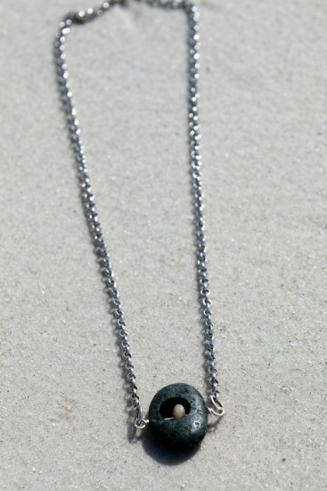 "charcoal rustic beach stone, routed, suspended polished beach stone on 24"" stainless steel chain"