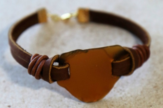 Amber seaglass piece on knotted leather straps - 7.25""