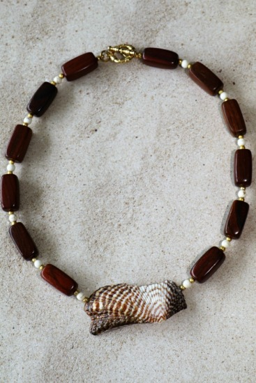 Wood, Bone and gold beaded necklace with Turkey Wing shell statement piece pendant, gold toggle clasp.  18 inch