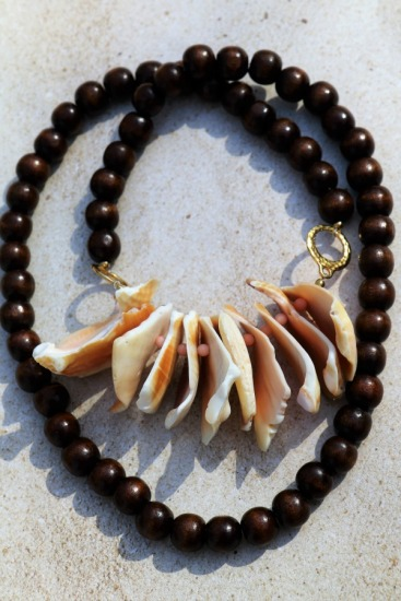 Tribal vibe shell necklace - dark wood beads, gold plated rings, fighting conch lip fragments, coral spacer beads - 34""