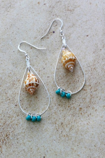 Boho-style earrings with mini conch shell, turquoise beads on silver hoops, sterling fishhook earwires