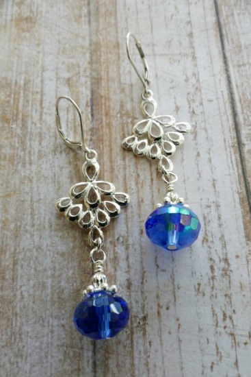 Boho-style drop earrings - irridescent blue faceted Czech crystals suspended from silver scrollwork pendant, sterling leverback earwires