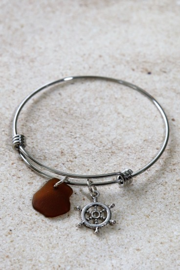 Stainless steel bangle with amber seaglass chip, ships wheel charm